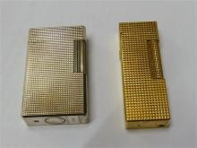 A silver plated Dupont lighter machined body with fluted cylinder form wheel,