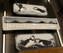 Three Highland stoneware dishes including a rectangular form dish with flock of sheep decoration,