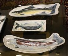 Three highland stoneware fish platters two of piscean form, one rectangular, longest 25in. (63.5cm.) long. (3)