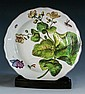 A Chelsea 'Hans Sloane' botanical soup plate c.1755, with painted red anchor mark and shaped brown line rim,