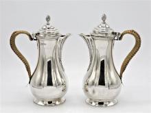 A pair of Edwardian silver coffee and hot milk jugs Daniel & John Wellby, London 1904, of George III form,
