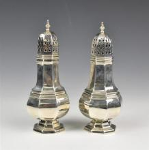 A pair of Elizabeth II silver sugar casters T. Hill, Birmingham 1972, of octagonal baluster form, 6 5/8in. (16.8cm.) high,