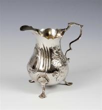 A George III silver baluster cream jug maker I. S. & A. N. (unknown), London 1770, with cut card rim,