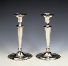 A pair of George VI silver candlesticks Israel Freeman & Son Ltd., London 1949,
