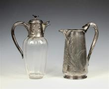 An Art Nouveau Gallia Christofle silver plate and glass claret jug the hinged lid with flower finial on a floral decorated collar wi...