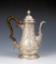 An early George III silver baluster coffee pot maker probably John Payne, London 1765, with repoussé floral, foliate,