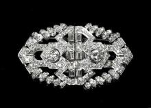 An Art Deco 18ct white gold and diamond double clip brooch the openwork plaque form brooch set throughout with brilliant,