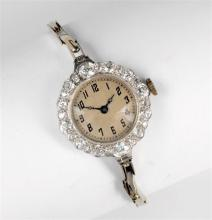 A platinum and diamond ladies cocktail watch 1930s-50s, the 15 jewel Swiss manual movement with 12mm. silvered Arabic dial,