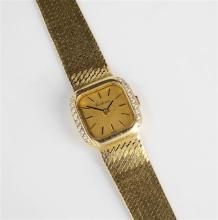 An 18ct yellow gold and diamond Certina ladies wrist watch quartz movement, the brushed gold squared dial, 19 x 19mm.,