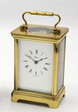 A brass carriage clock by Henley of England late 20th century, single train movement signed 'Henley England',