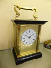 A gilt brass and polished slate carriage clock by Henley of England the single train movement signed 'Henley England',