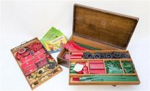 A 1950s Meccano Outfit No. 10 the near complete set in original mahogany box with handles to the sides and gilt lettering to lid,