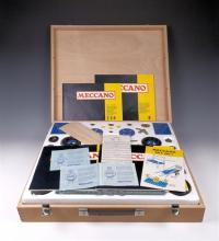 A 1970s Meccano Outfit No. 9 the virtually complete set appears unused within its original blonde wood case,