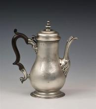 A George III silver coffee pot Thomas Parr II, London, 1741, plain body of baluster form,