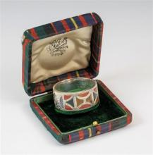A rare Edwardian cased silver & Scottish hardstone napkin ring Joseph Cook & Son, Birmingham, 1908, the ring inlaid with red,