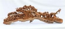 An Indian trunk carved wooden elephant scene second half 20th century,