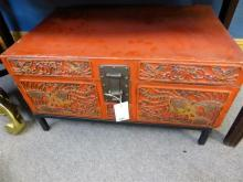 A Chinese red lacquer leather marriage chest c 1920's, on stand, decorated with Chinese symbols and heavy bronze clasps,