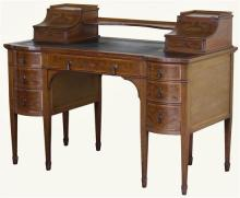 An Edwards & Roberts fiddleback mahogany and marquetry desk of bowed breakfront outline,