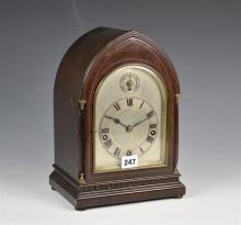 A late Victorian inlaid mahogany lancet top musical quarter chiming bracket clock movement by Winterhalder & Hofmeier,