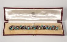 A Stuart Devlin for Collingwood 18ct white gold, ruby, turquoise, seed pearl and lapis lazuli bracelet hallmarked London,