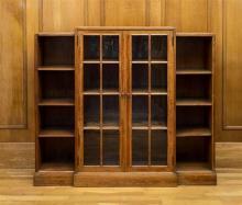 An Art Deco walnut part glazed breakfront bookcase by Heal & Son Ltd. c.1930,