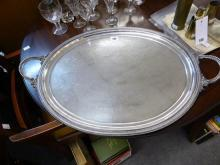 A 19th century silver plated twin handled tray oval, with chased foliate decoration surrounding an eight pointed star,