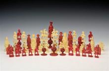 A collection of Chinese Canton carved red and natural stained ivory chess pieces 19th century, from various sets,