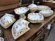 An early 19th century Derby porcelain part dinner service iron red painted factory marks,
