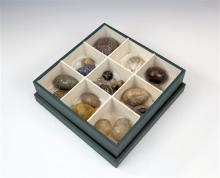 A collection of Victorian carved hardstone eggs and marbles including thirteen eggs in lalis lazuli, Blue John, serpentine,
