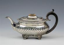 A George III silver teapot Joseph Angell I, London, 1818, of bombe form,