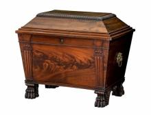 A George IV Irish mahogany wine cooler or cellarette of large proportions, sarcophagus form,