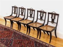 A set of five Regency ebonised beech wood lyre back neo-classical side chairs the plain,
