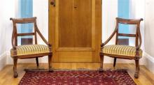A fine pair of Regency neo-classical inlaid partridgewood side chairs in the manner of Thomas Hope the scrolled top rails inlaid wit...