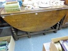 An 18th century oak gateleg dropflap 'ship's' dining table the oval top over a single frieze drawer to each end,
