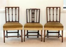 A pair of George III ash side chairs the rectangular backs with flared bars centred with ovals, over stuffover seats,