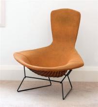 A 'bird' chair by Harry Bertoia 1970s, in original orange coarse weave upholstery,