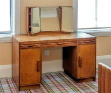 A good quality 1930s Art Deco red walnut and ash dressing table the plain rectangular top with central swing mirror flanked by a pai...