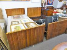A rare pair of 1930s Art Deco oak single beds the angular head and foot boards with bold reeded moulding,