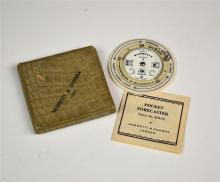 An ivorine pocket weather forecasting calculator by Negretti & Zambra, London early 20th century, formed as three rotating discs,