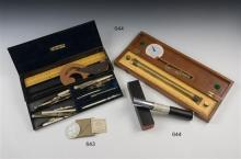 A mahogany cased boxwood and brass rolling parallel rule by W. H. Harling, London 15in. (38cm.) long,