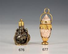 A 19th century miniature gold and hardstone scent bottle the flattened bottle form scent flask with floral and foliate gold mounts a...