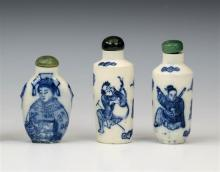 Three Chinese porcelain snuff bottles two of flask form, the other of flattened ovoid form, decorated in underglaze blue with figures,