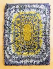 A 1950s modernist 'Sunburst' design Rya rug the long tufted rug in orange, yellows, ivory, greys and greens,