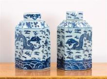 A matched pair of Chinese blue and white porcelain hexagonal canisters with lids decorated with flying dragons chasing flaming pearl...