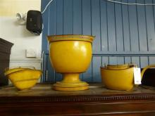 A Pontypool yellow japanned oval coal purdonium, reed basket and kettle 19th century,