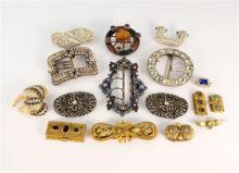 A collection of antique and vintage paste and other costume buckles and clips late 19th century to mid-century,