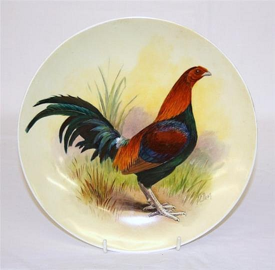 A handpainted shallow dish by James Edwin Dean painted with a cockerel in a landscape, impressed mark Minton and MN,