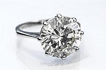 A fine platinum and diamond solitaire ring the 5.04 carat round brilliant cut diamond measuring 11.3 x 11.21 x 6.34mm.,