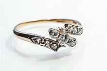 An 18ct yellow gold and diamond twist ring 1930s-40s,