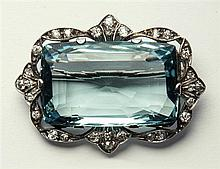 A fine Edwardian platinum, aquamarine and diamond brooch the large cushion cut aquamarine measuring 26 x 16mm.,